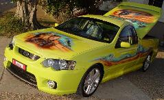 Airbrushed murals on Ford Pursuit